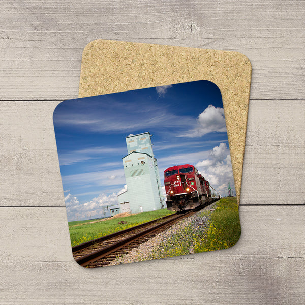 Drink Coasters of CN locomotive driving pst Innisfail by Larry Jang