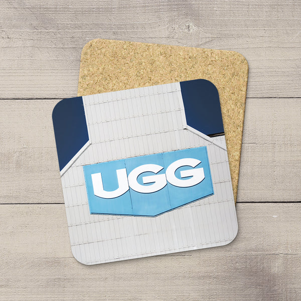 Photo coasters featuring United Grain Growers logo as photographed from aside of a grain elevator by Larry Jang.