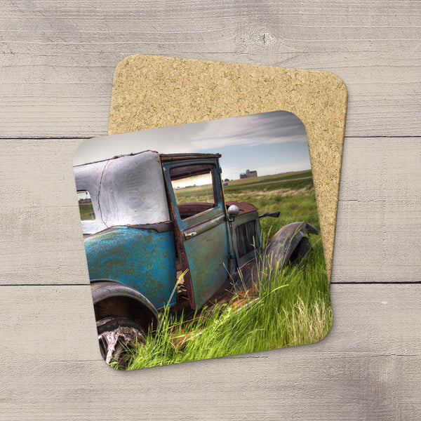 Jalopy sitting in a Saskatchewan Prairie Field. Drink Coasters hand made art by acclaimed Canadian Photographer Larry Jang.