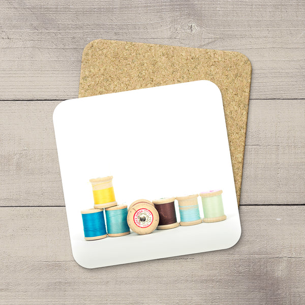 Sewing Room Accessories Ideas. Beverage Coasters featuring a picture of Vintage & Colorful wooden thread spools. Modern functional table decor by Edmonton artist & photographer.