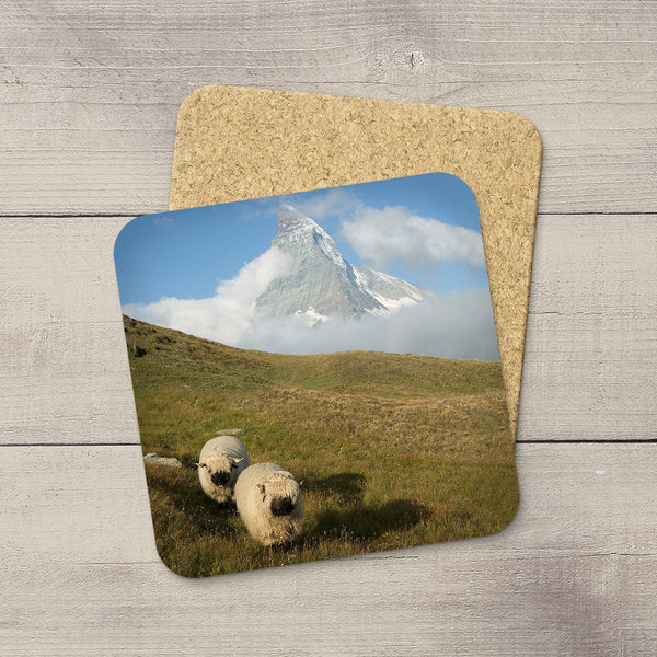 Photo Coaster of a cute pair of sheep running by the Matterhorn in Switzerland by Larry Jang