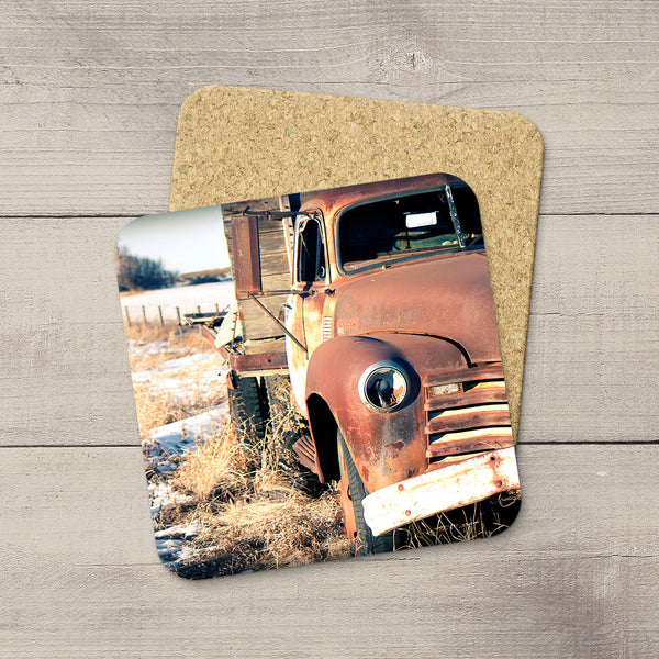 Rusty 50s Ford Truck sitting in a field in the winter. Drink Coasters hand printed by acclaimed Canadian Photographer Larry Jang.