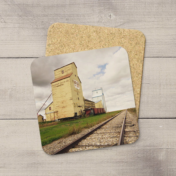 Mossleigh grain elevators picture hand printed onto drink coasters by Larry Jang.