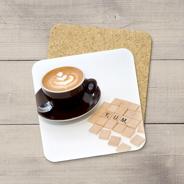Kitchen Decor Ideas. Photo Coasters of Cappuccino and Scrabble Tiles spelling YUM. Modern functional table decor by Edmonton artist & photographer.