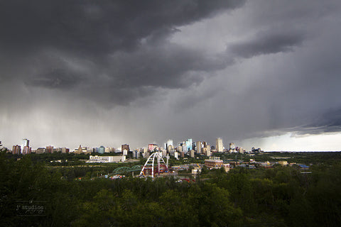 Image of a summer storm over the city of Edmonton featuring the Walterdale bridge. Urban photography.