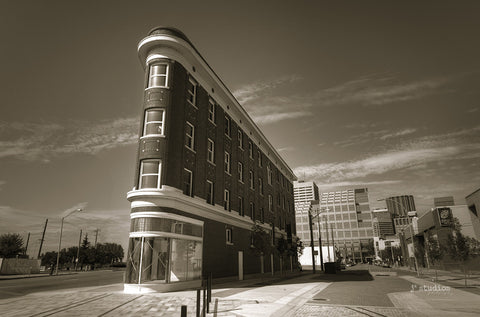 Gibson Block is a vintage inspired art print of the triangular flatiron building in the Quarters district of Edmonton.