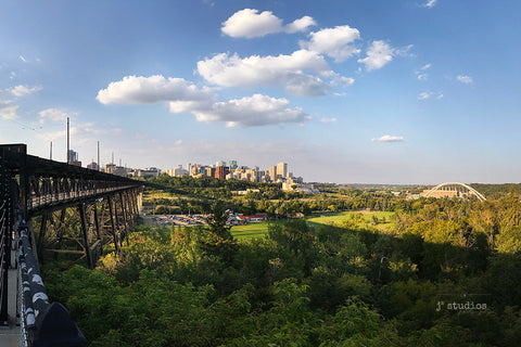Image of Edmonton's River Valley with the High Level Bridge and City Skyline looming over the North Saskatchewan River. Explore Alberta themed photography.