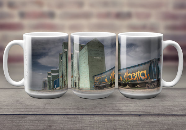 Big oversized Coffee Mugs featuring a wrap around image of grain elevator row and an Alberta Hopper car in Warner, Alberta. Great gift idea that celebrates Life in the Canadian Prairies. Handmade in Edmonton, Canada by photographer & artist Larry Jang.