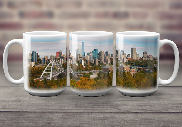 Big oversized Coffee Mugs featuring a wrap around image of the City of Edmonton skyline in the fall. Includes Walterdale Bridge, River Valley & Stantec tower. Great gift idea that celebrates Life in the Canadian Prairies. Handmade in Canada by photographer & artist Larry Jang. Unique souvenirs.