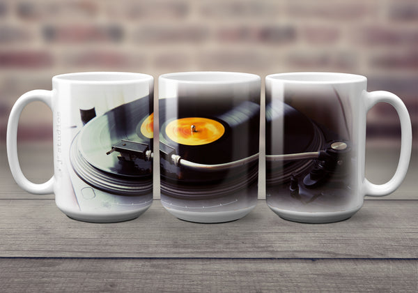 Urban themed 15 oz Coffee Mug for music lovers. It features a wrap image of a turntable playing a record in a cafe. Handmade in Edmonton, Canada by photographer & artist Larry Jang.