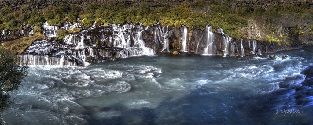 Hraunfossar is an art print of a series of waterfalls formed by rivulets that pour into the Hvítá river
