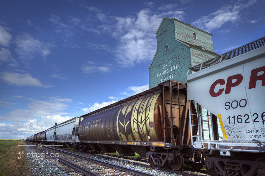 Image of a train rolling into the Ghost Town of Brant. Canadian Prairies Photography.