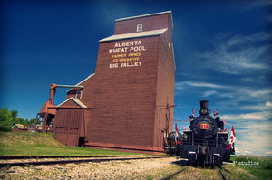 Picture of the Engine 41 Steam Locomotive parked on the railroad tracks outside of Big Valley Grain Elevator. Alberta Prairies photography by Larry Jang