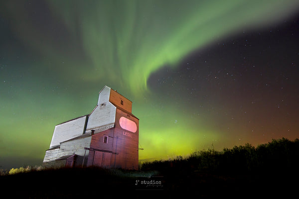 Auroras dancing over Grain Elevator in Legal, Alberta.