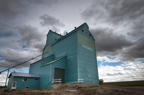 Storm Clouds over Arrowwood Grain Elevator on Alberta Prairies. Photography by Larry Jang of J² Studios Photography & Craft.