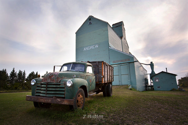 Image of a 1950s Vintage Truck parked in front of the Andrew grain elevator.  Photography of the Canadian Prairies by Larry Jang.