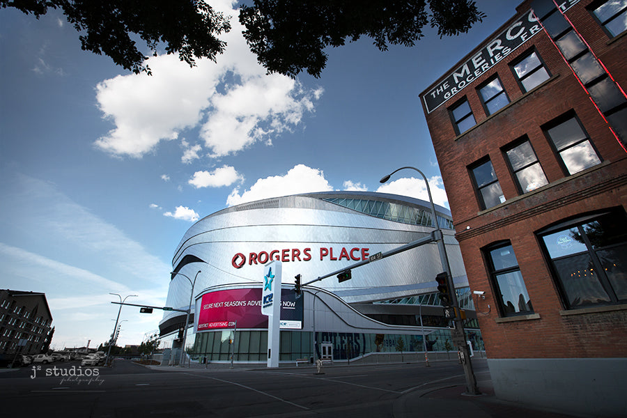 Image of modern and vintage architecture on 104th street promenade in Edmonton, Alberta. Rogers Place and Mercer Warehouse. Urban Photography.
