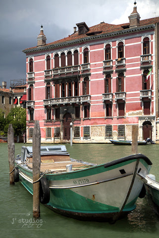 A Boat in Venice is an image on the grand Venetian canal.