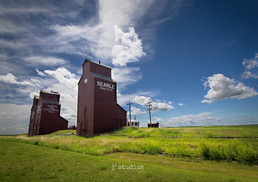 Image of the trio of grain elevators in the ghost town of Rowley, Alberta. Canadian prairies photography.