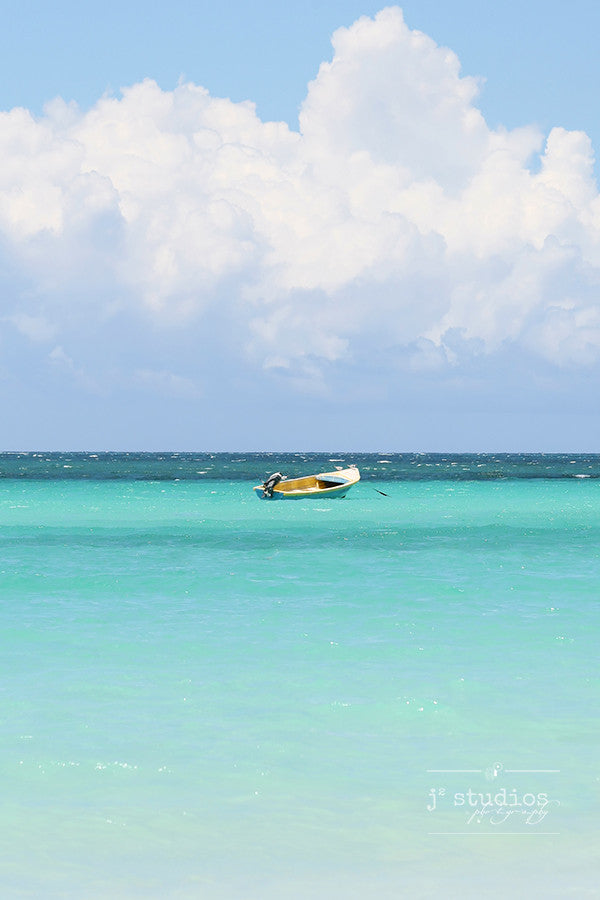 Adrift is an art print of a boat floating on the Caribbean Sea in Jamaica.
