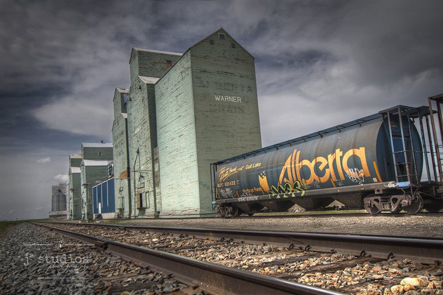 Alberta Bound is an image of Railway Avenue in Warner, Alberta. Grain Elevator Photography.