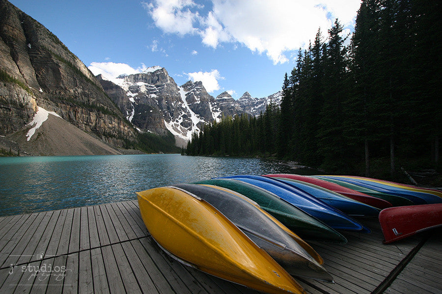 All Done With the Canoes is an art print of Moraine Lake in Banff National Park.