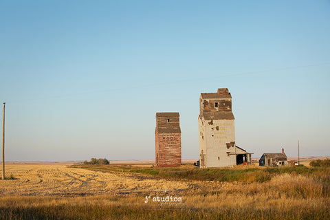 Sentimental vintage themed image of Dankin, a ghost town in Saskatchewan Canada. Grain elevator photography.
