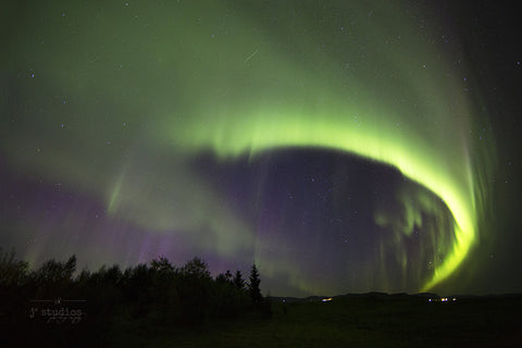 Arcing Over Iceland is an art print of the northern lights dancing in the heavens above Iceland. Fine Art photography.