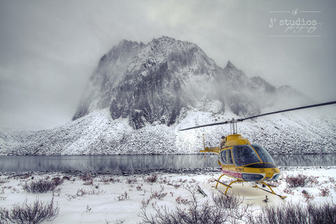 Arrival is an image of a helicopter on Talus Lake and the Tombstone Mountain range in the winter. Yukon Photography.