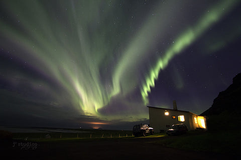 Image of a vivid and colorful northern lights show over South Iceland. Northern Lights Photography.