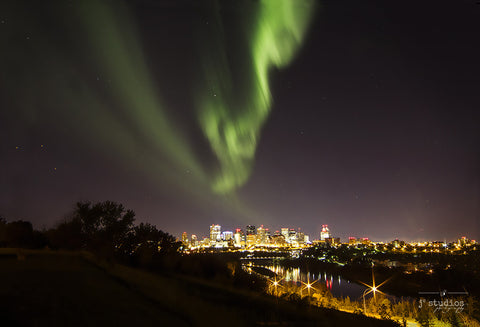 Aurora Over Edmonton #1 is an art print of the northern lights forming over the city of Edmonton.