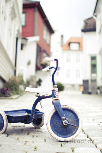 Big Wheels is an art print of a blue tricycle in Bergen Norway.