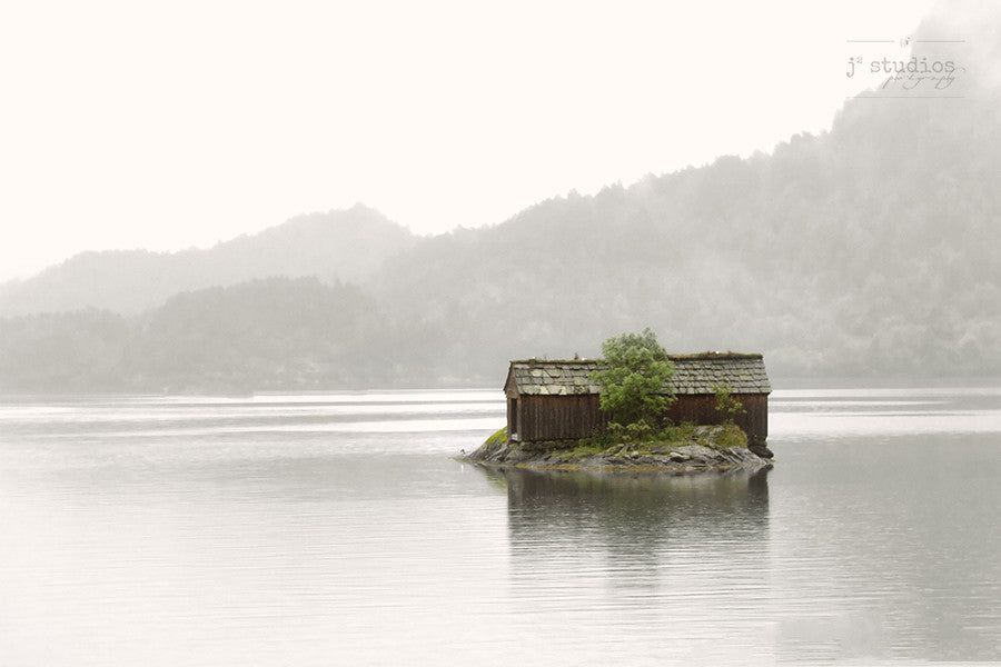 Boathouse in the Mist is an image of a weather worn boat shelter on a fjord in Norway.
