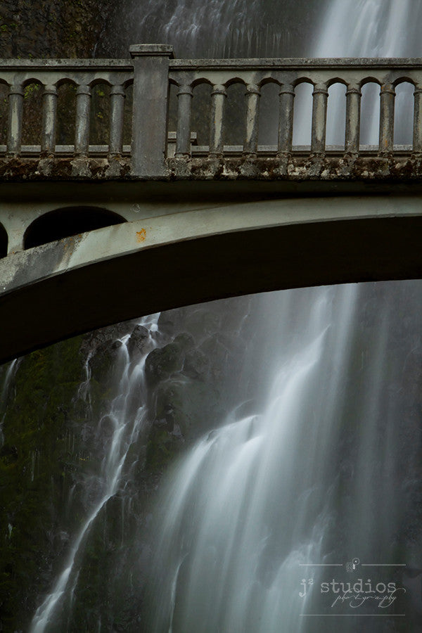 Bridge Over Troubled Waters is an intimate image of Multnomah Creek Bridge with the rapids of the Upper Falls behind it.