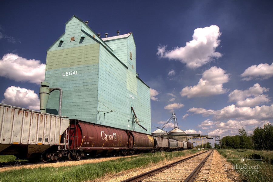 Picture of grain elevator in Legal, Alberta with a Canada hopper car parked on train tracks.