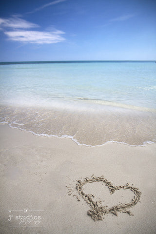 Caribbean Love is an art print of a heart in the sand on a beach in Cuba.