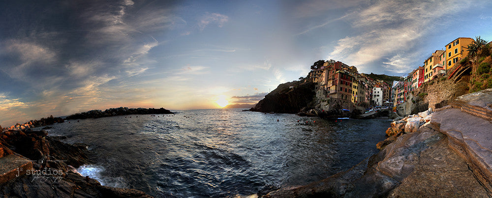 Image of the village of Riomaggiore at sunset in the Cinque Terre, Italy.
