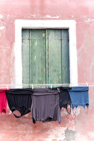 Clothes Line is an art print of drying laundry in Burano, Italy.