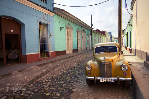 Cuba Classic #1 is an image of a old yellow car on the streets of Trinidad. Beautiful old car photography.