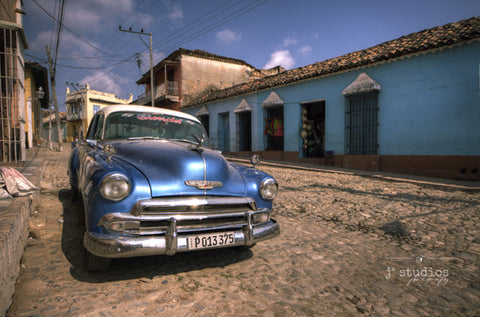 Cuba Classic #2 is a photograph of a Blue Chevy sitting on the streets of Trinidad.