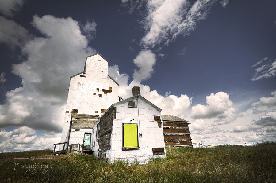 Art Print of the weathered white Ogilvie grain elevator in Wrentham, Alberta. Canadian prairies photography by Larry Jang.