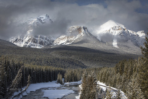 Family themed image of Haddo Peak, Saddle Mountain and Mount Fairview in Banff National Park. Winter Photography.