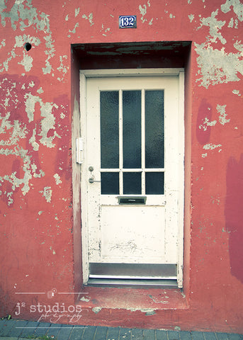 Flakes of Salmon is an art print of a white door on a salmon colored wall in Reykjavik Iceland. Images of doors.