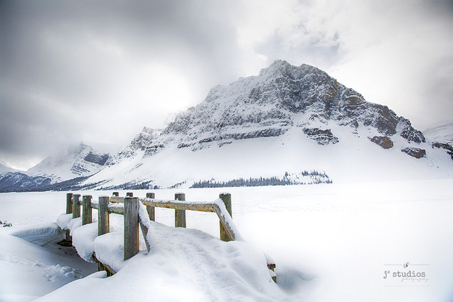 Frozen bridge is an art print of Banff National Park in the Winter. Canadian Winter Landscape Photography.