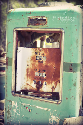 Gas Pump Flashback is an image of a vintage and rusty spring green gasoline pump. Circa 1950s or 1960s.