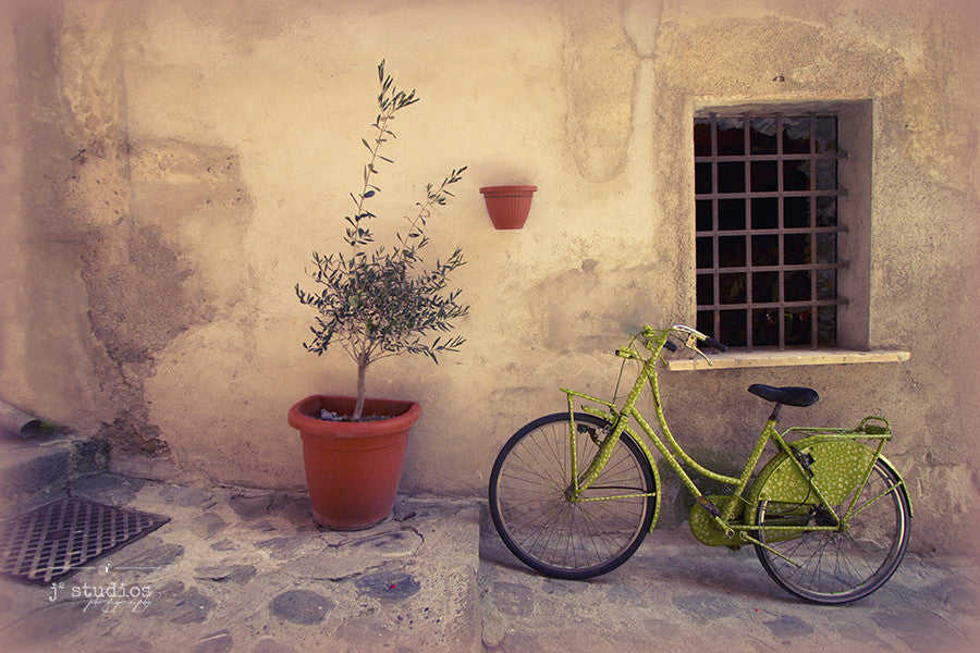 Green Bicycle is an image of a lime green bicycle parked in a charming alleyway in the Cinque Terre of Italy. Travel Photography.