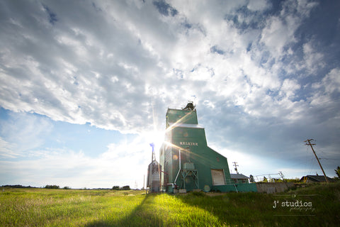 Wanderlust inspired summer themed image of the Alberta Wheat Pool grain elevator located in the village of Halkirk in Central Alberta. Rural Photography by J² Studios.