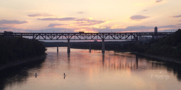 High Level Crossing is an image of sunset over the bridge and the North Saskatchewan River.