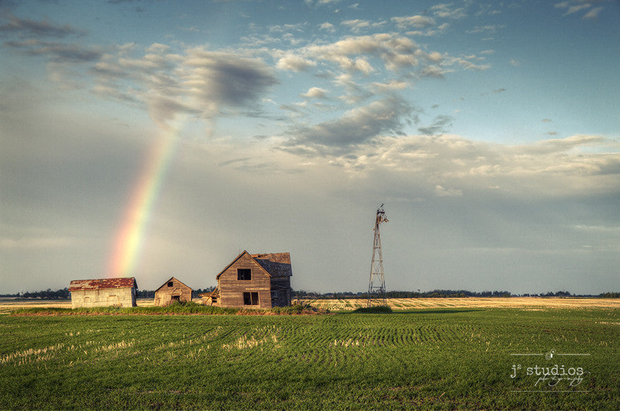 Hope is an art print of a rainbow arcing down onto an abandoned home. Storytelling photograph.