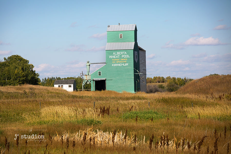 Love this beautiful grain elevator nestled in the valley surrounded by gorgeous fall colors. A definite love where you live moment! Canadian prairies photography. Kirriemuir.